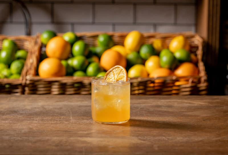 The French Riviera, a seasonally-inspired cocktail from Mixology Events' brand-new spring menu, rests on a bar