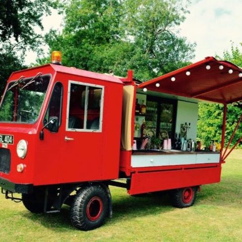 A mobile beer truck, a converted Caddy Wagon, set up in a back garden for a recent mobile cocktail bar hire