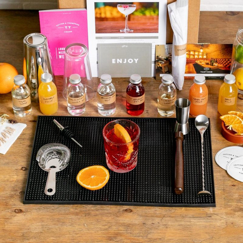 A picture of the Mixology Events virtual cocktail making class kit contents laid out on a table