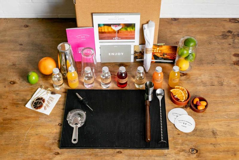 The box contents for a Mixology Events virtual cocktail making class, laid out on a counter top
