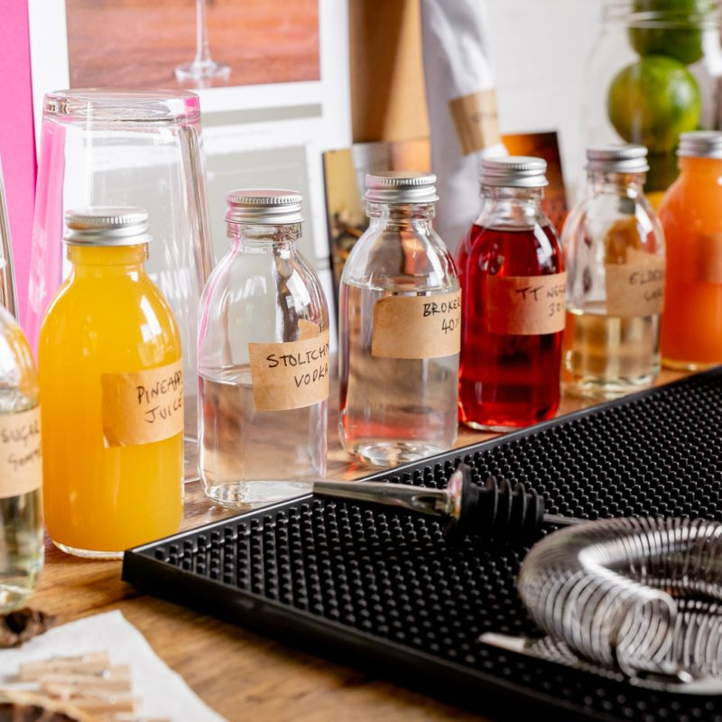 A close up picture of the premium spirits and ingredients used during a Mixology Events virtual cocktail making class