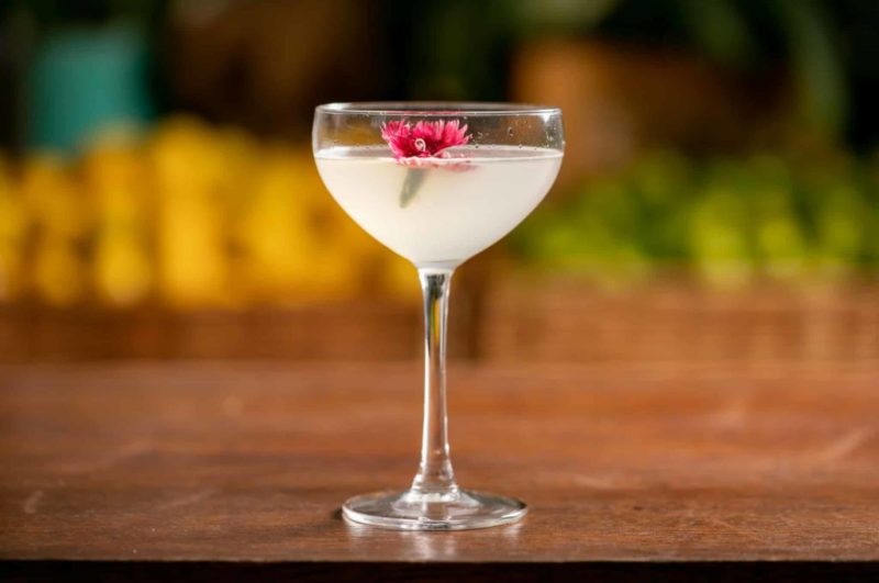 The Breakfast Martini, a classic gin cocktail from Mixology Events Virtual Gin Cocktail Making Classes, rests on a bar