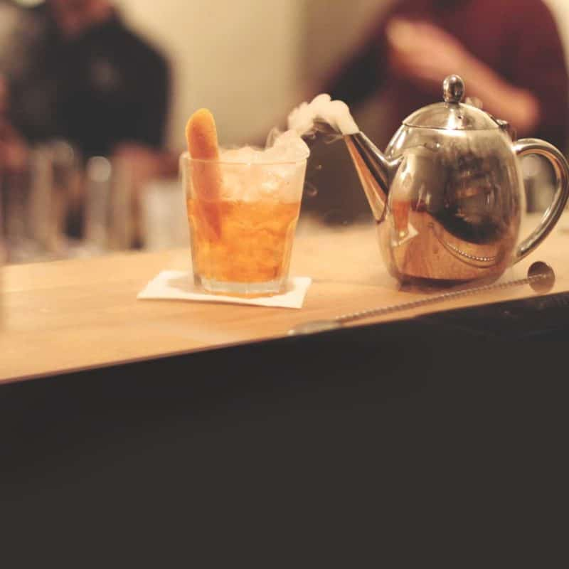 A molecular cocktail with Jasmine tea vapours created by dry ice during a molecular class