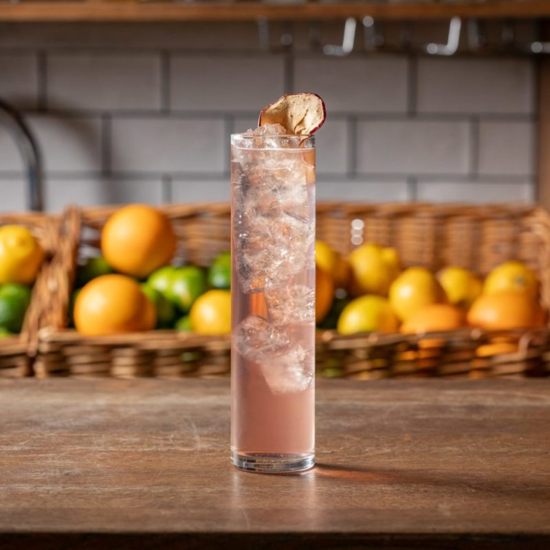 A freshly made welcome drink from Mixology Events' cocktail making classes rests on a bar