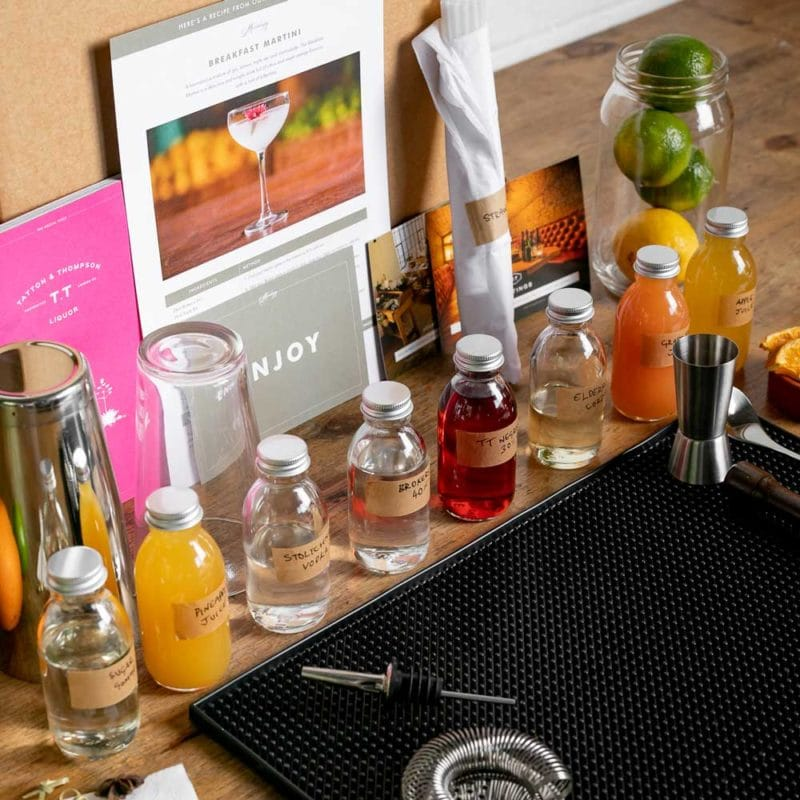 Virtual cocktail making kit all laid out on a table top
