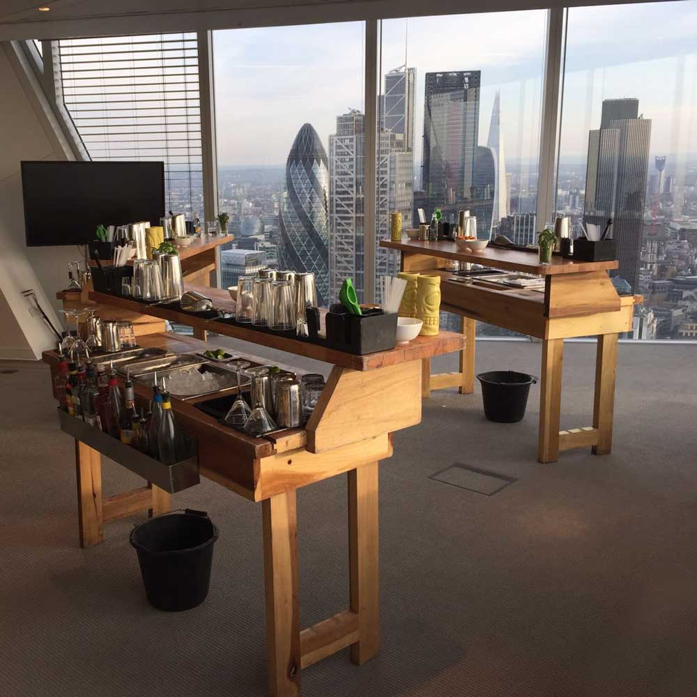 Cocktail bars set up in a skyscraper overlooking London skyline