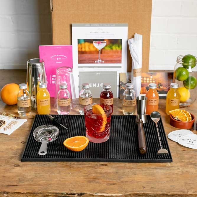 Cocktail making kit all laid out on a table top